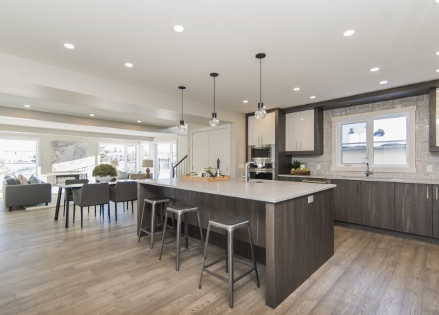 A beautiful shot of a modern house kitchen and dining room